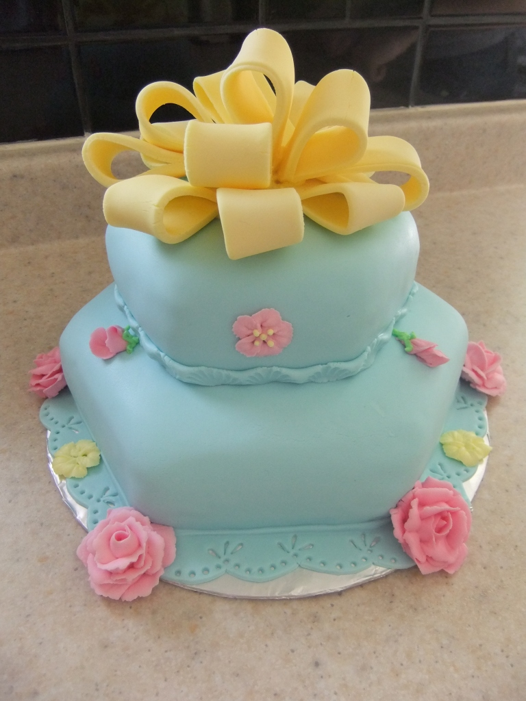 Red Velvet Cake covered in blue fondant with layers of frosted Vanilla Buttercream.