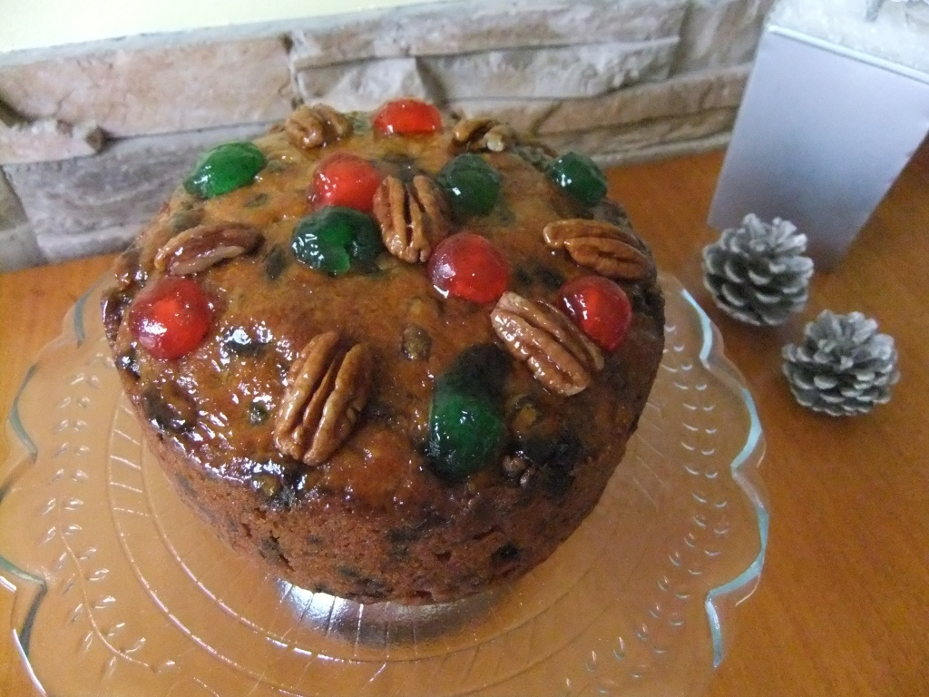 """Beautiful 6"""" Fruitcake filled with fruits & Nuts, offered in Rum or Brandy or a med-light or dark cake"""