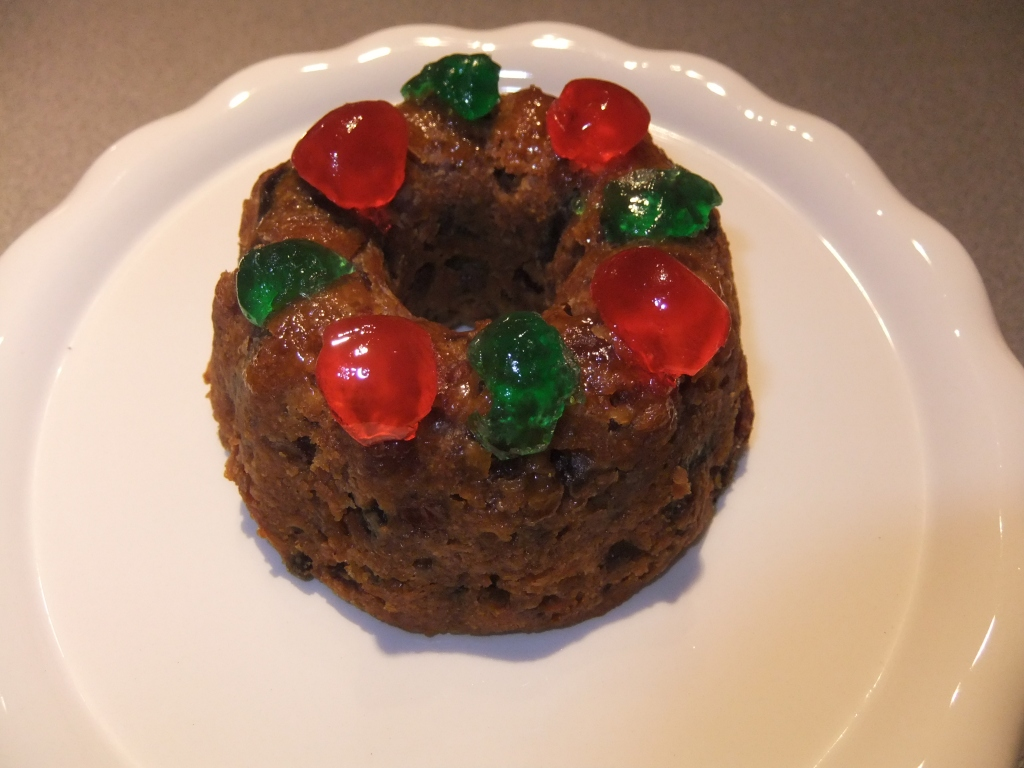 Mini Fruitcakes, loaded with  tons of dried fruit and nuts and deliciously soaked in Rum, yum-yum.