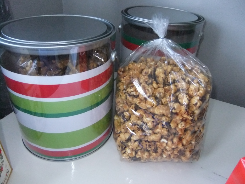 Caramel Popcorn with a Chocolate Drizzle.  Comes in a food safe Clear Paint Can.