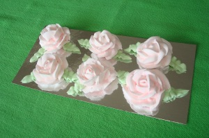 "Large Roses in ""Blush"" with leaves."