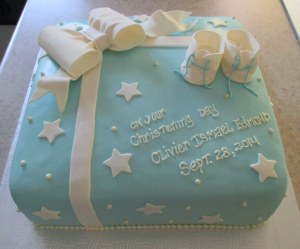 White Cake with a Mocha Cream Filling Frosted in a Vanilla Swiss Buttercream and covered in Blue Fondant.