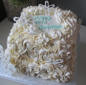 White Cake with a Lemon Cream Filling frosted with a Vanilla Swiss Buttercream...Y-U-M